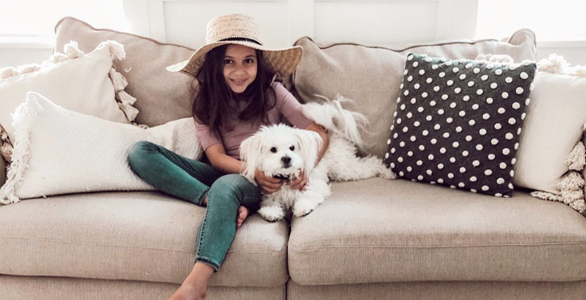 Young on the couch with Dog