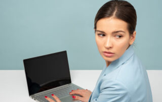 Concerned Woman looking BAck while Sitting at computer